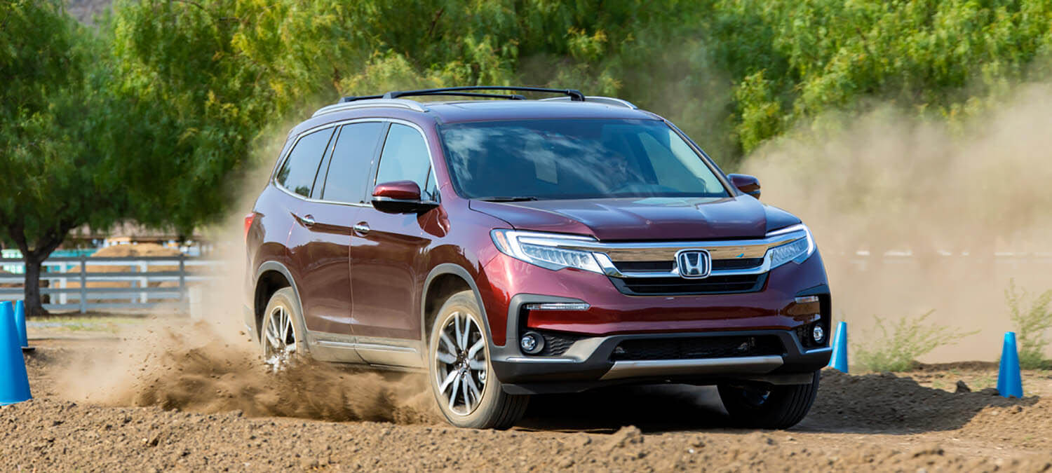 2020 Honda Pilot AWD Exterior Front Angle Passenger Side Dirt Road